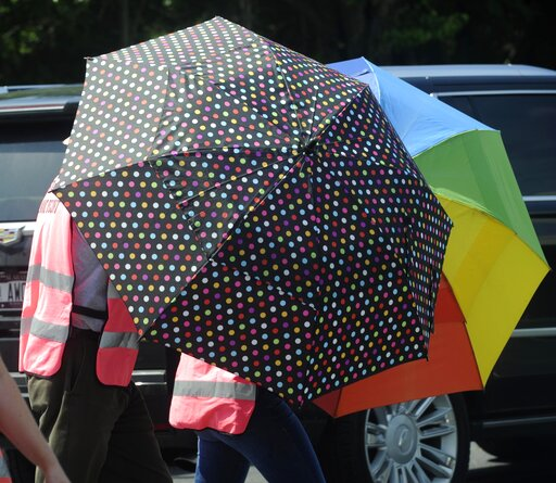 (AP Photo/Eric Schultz). Escorts, using umbrellas, shield clients from the gestures and voices of anti-abortion activists standing on the sidewalk in front of the Alabama Women's Wellness Center Friday, May 17, 2019 in Huntsville, Ala. The Alabama legi...