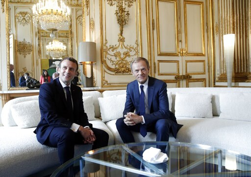 (Yoan Valat/Pool via AP). French President Emmanuel Macron, left, meets with European Council President Donald Tusk at the Elysee Palace in Paris, Monday, May 20, 2019.