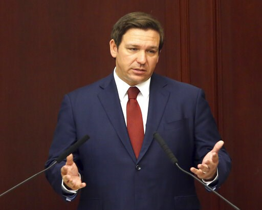 (AP Photo/Steve Cannon, File). FILE- In this March 5, 2019 file photo. Florida Gov. Ron Desantis gives his state of the state address on the first day of legislative session, in Tallahassee, Fla. DeSantis is going to Israel with a large contingent of b...