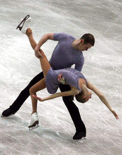 (AP Photo/File). FILE - In this Dec. 8, 2006, file photo, Bridget Namiotka and John Coughlin perform during the ISU Junior Grand Prix of Figure Skating Final in Sofia, Bulgaria. One of the former skating partners of two-time U.S. pairs champion John Co...