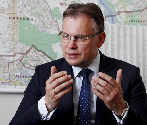 (AP Photo/Czarek Sokolowski). Poland's ruling party lawmaker Arkadiusz Mularczyk talks to The Associated Press in the parliament building in Warsaw, Poland, on Tuesday, May 21, 2019, about a report that assesses Poland's World War II losses and that, h...