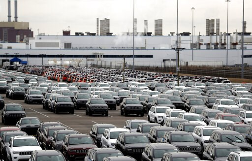 (AP Photo/Carlos Osorio, File). FILE- In this Feb. 26, 2019 file photo, Jeep vehicles are parked outside the Jefferson North Assembly Plant in Detroit. Fiat Chrysler can move forward with plans to build a new, $1.6 million assembly plant on Detroit's E...