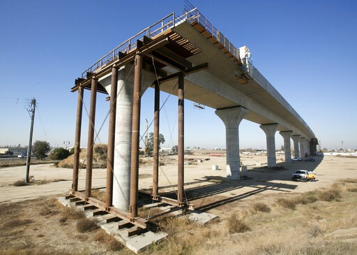 (AP Photo/Rich Pedroncelli, File). FILE - This Dec. 6, 2017, file photo shows one of the elevated sections of the high-speed rail under construction in Fresno, Calif. California has sued to block the Trump administration from cancelling nearly $1 billi...