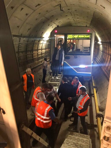 (mosmetro.ru via AP). Subway workers help commuters to a replacement train in the Moscow Metropolitan in Moscow, Russia, Tuesday, May 21, 2019. About 1,000 commuters remained trapped on the subway for several hours due to a power outage until they were...