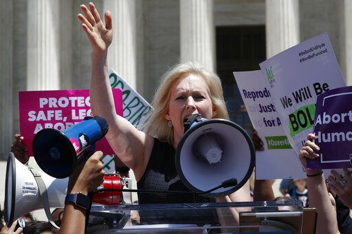 (AP Photo/Jacquelyn Martin). Democratic presidential candidate Sen. Kirsten Gillibrand, D-N.Y., speaks during a protest against abortion bans, Tuesday, May 21, 2019, outside the Supreme Court in Washington. A coalition of dozens of groups held a Nation...