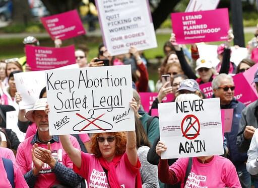 (AP Photo/Rich Pedroncelli). People gather at the state Capitol to rally in support of abortion rights, Tuesday, May 21, 2019, in Sacramento, Calif.