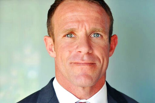 (Andrea Gallagher via AP, File). FILE - This 2018 file photo provided by Andrea Gallagher shows her husband, Navy SEAL Edward Gallagher, who has been charged with murder in the 2017 death of an Iraqi war prisoner. Lawyers on Gallagher's defense team to...