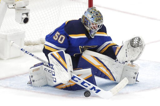 (AP Photo/Tom Gannam). St. Louis Blues goaltender Jordan Binnington blocks a shot against the San Jose Sharks during the third period in Game 6 of the NHL hockey Stanley Cup Western Conference final series Tuesday, May 21, 2019, in St. Louis.