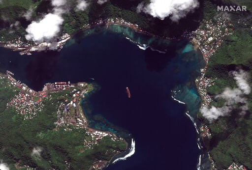 "(Satellite image ©2019 Maxar Technologies via AP). This Sunday, May 19, 2019 satellite image provided by Maxar Technologies shows the North Korean cargo ship ""Wise Honest,"" center, in Pago Pago, American Samoa. North Korea's U.N. ambassador says the Tr..."