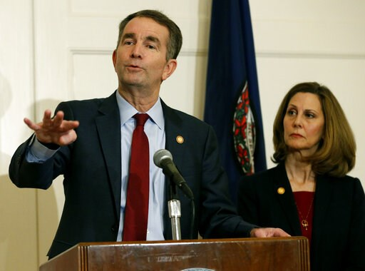 (AP Photo/Steve Helber, File). FILE - In this Feb. 2, 2019 file photo, Virginia Gov. Ralph Northam, left, gestures as his wife, Pam, listens during a news conference in the Governors Mansion at the Capitol in Richmond, Va. A law firm has completed its ...