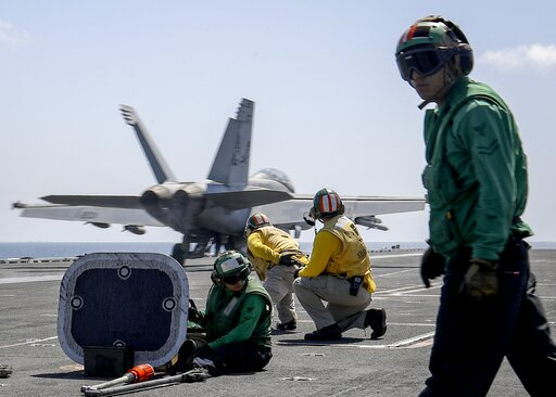 "(Mass Communication Specialist 3rd Class Jeff Sherman/U.S. Navy via AP). In this Monday, May 20, 2019 photo, released by U.S. Navy, an F/A-18E Super Hornet from the ""Jolly Rogers"" of Strike Fighter Squadron (VFA) 103 launches from the flight deck of th..."