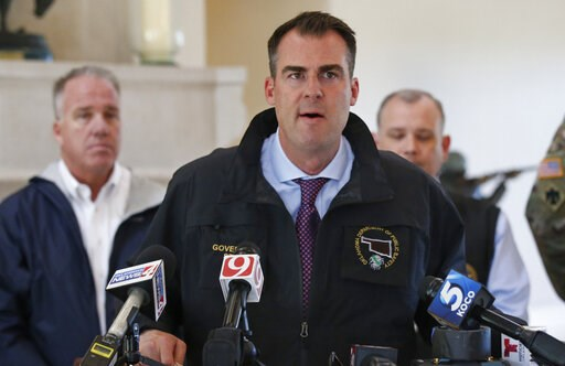 (AP Photo/Sue Ogrocki). Oklahoma Gov. Kevin Stitt talks with the media following an aerial tour of tornado and flood damaged areas of the state, Tuesday, May 21, 2019, in Oklahoma City.