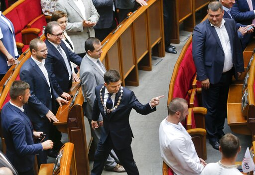 (AP Photo/Efrem Lukatsky). In this photo taken on Monday, May 20, 2019, Ukrainian new President Volodymyr Zelenskiy,  centre, leaves the parliament after his inauguration ceremony in Kiev, Ukraine. Ukrainian TV star Volodymyr Zelenskiy was sworn in as ...