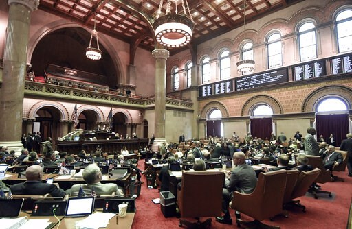 (AP Photo/Hans Pennink). Members of the New York state Assembly vote on legislation that authorizes state tax officials to release, if requested, individual New York state tax returns to Congress, during a session in the Assembly Chamber at the state C...