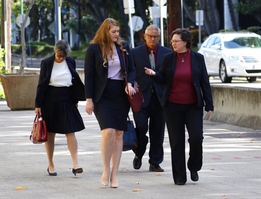 (AP Photo/Caleb Jones). Former Honolulu police chief Louis Kealoha, second from right, and his former deputy city prosecutor wife Katherine Kealoha, right, walk into federal court in Honolulu on Wednesday, May 22, 2019. A trial for what has been descri...