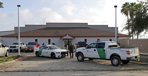 (AP Photo/David J. Phillip, File). FILE - In this June 23, 2018 file photo, a U.S. Border Patrol Agent walks between vehicles outside the Central Processing Center in McAllen, Texas. U.S. border agents have temporarily closed their primary facility for...
