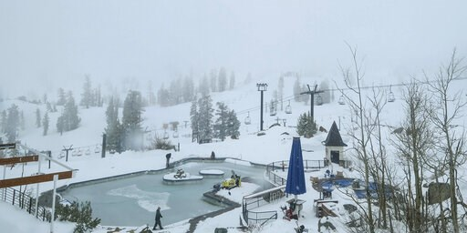 (Squaw Valley Alpine Meadows via AP). In this webcam image provided by Squaw Valley Alpine Meadows is the snow covered Squaw Valley High Camp Wednesday, May 22, 2019, in Olympic Valley, Calif. Memorial Day may be the unofficial start of summer, but Cal...