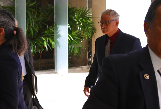 (AP Photo/Caleb Jones). Former Honolulu police chief Louis Kealoha, right, walks into federal court in Honolulu on Wednesday, May 22, 2019. A trial for what has been described as the biggest corruption case in Hawaii history began Wednesday for Kealoha...