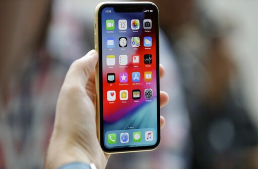 (AP Photo/Marcio Jose Sanchez, File). FILE - This Sept. 12, 2018, file photo shows an Apple iPhone XR on display at the Steve Jobs Theater after an event to announce new products, in Cupertino, Calif. A Chinese national in Oregon sent hundreds of suppo...