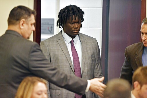 (George Walker IV/The Tennessean via AP, Pool, File). FILE - In this May 20, 2019, file photo, Emanuel Kidega Samson, 27, center, enters the courtroom in Nashville, Tenn. Samson, accused of fatally shooting one person and wounding seven others in a Nas...