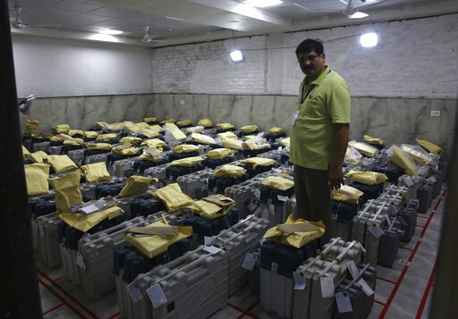 (AP Photo/Manish Swarup). An election official checks electronic voting machines as counting votes of India's massive general elections begins in New Delhi, India, Thursday, May 23, 2019. The count is expected to conclude by the evening, with strong tr...