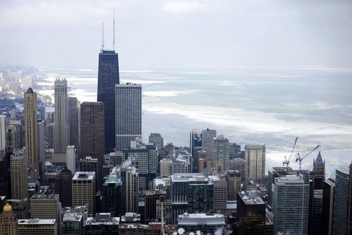 (AP Photo/Kiichiro Sato, File). FILE - In this Feb. 17, 2015, file photo, ice covered Lake Michigan is seen behind downtown skyline, in Chicago. Big cities, like Chicago, aren't growing like they used to. New figures released by the U.S. Census Bureau ...