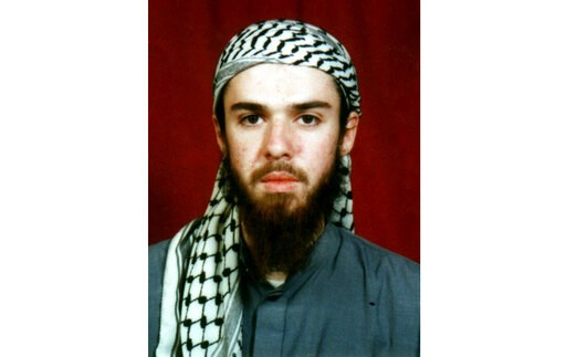 (AP Photo, File). FILE - American John Walker Lindh is seen in this undated file photo obtained Tuesday, Jan. 22, 2002, from a religious school where he studied for five months in Bannu, 304 kilometers (190 miles) southwest of Islamabad, Pakistan. Lind...