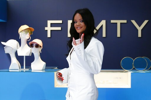 (AP Photo/Francois Mori). Singer Rihanna, the first black woman in history to head up a major Parisian luxury house, poses as she unveiled her first fashion designs for Fenty at a pop-up store in Paris, France, Wednesday, May 22, 2019. The collection, ...