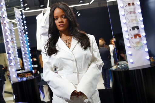 (AP Photo/Francois Mori). Rihanna poses as she unveils her first fashion designs for Fenty at a pop-up store in Paris, France, Wednesday, May 22, 2019.  Singer Rihanna is the first black woman in history to head up a major Parisian luxury house, and th...