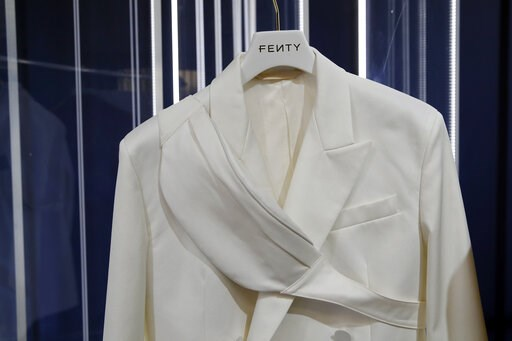 (AP Photo/Francois Mori). A design by Rihanna is unveiled as her first fashion designs for Fenty at a pop-up store in Paris, France, Wednesday, May 22, 2019.  Singer Rihanna is the first black woman in history to head up a major Parisian luxury house, ...