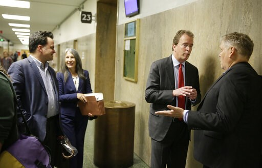 (AP Photo/Eric Risberg). In this photo taken Tuesday, May 21, 2019, from left, David Snyder, an attorney with the First Amendment Coalition, attorney Duffy Carolan, and Thomas Burke, attorney for freelance journalist Bryan Carmody, talk outside a court...