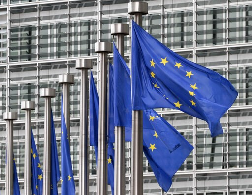 (AP Photo/Yves Logghe, File). FILE - In this May 9, 2011 file photo, EU flags fly outside the European Commission headquarters in Brussels. Disinformation has evolved beyond the playbook used by Russian trolls in the U.S. election. As the European Unio...