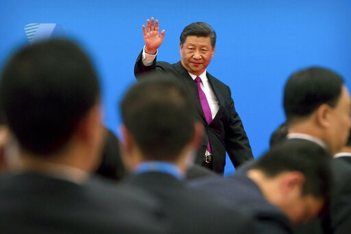 (AP Photo/Mark Schiefelbein, File). FILE - In this Saturday, April 27, 2019, file photo, Chinese President Xi Jinping waves as he leaves after a news conference on the outskirts of Beijing. Fuming over Washington's latest tariff hike in an escalating t...