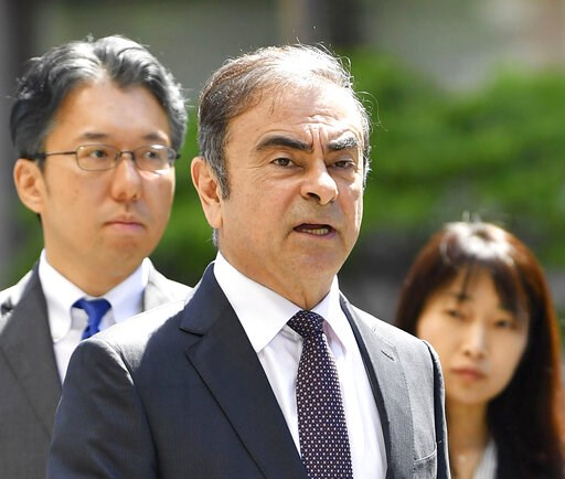(Ren Onuma/Kyodo News via AP). Former Nissan chairman Carlos Ghosn, center, arrives at Tokyo District Court for a pre-trial meeting in Tokyo Thursday, May 23, 2019. Ghosn, who is out on bail, has been charged with under-reporting his post-retirement co...