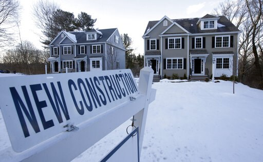 (AP Photo/Steven Senne, File). FILE- In this Feb. 21, 2019, file photo a newly constructed homes sit near a sign in Natick, Mass. On Thursday, May 23, the Commerce Department reports on sales of new homes in April.