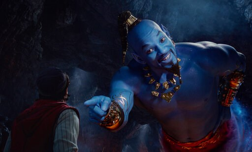 """(Disney via AP). This image released by Disney shows Mena Massoud as Aladdin, left, and Will Smith as Genie in Disney's live-action adaptation of the 1992 animated classic """"Aladdin."""" Rotten Tomatoes is taking another step to verify that users posting a..."""