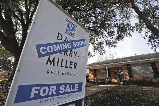 (AP Photo/LM Otero, File). FILE- In this Feb. 20, 2019, file photo a coming soon for sale sign sits in front of a home in the Dallas suburb of Richardson, Texas. On Thursday, May 23, Freddie Mac reports on this week's average U.S. mortgage rates.