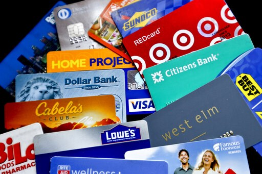 (AP Photo/Keith Srakocic, File). FILE- In this Jan. 31, 2018, file photo, an assortment of credit cards and rewards cards are shown in Zelienople, Pa. Rewards-earning credit cards can help you save on these expenses — but you can also combine those rew...