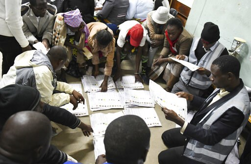 (AP Photo/Thoko Chikondi). In this Tuesday, May 21, 2019, photo, vote counting gets underway in Blantyre, Malawi. The country went to the polls to elect a new president in which 78-year-old President Peter Mutharika is seeking re-election to a second t...