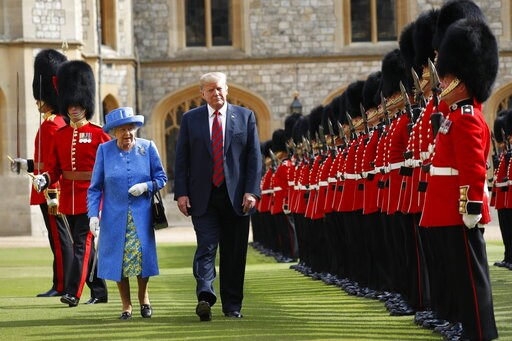 (AP Photo/Pablo Martinez Monsivais). FILE - In this July 13, 2018 file photo, U.S. President Donald Trump with Queen Elizabeth II, inspects the Guard of Honour at Windsor Castle in Windsor, England. Trump's next few weeks will serve as a master's class...