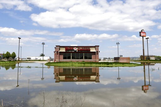 (AP Photo/Nati Harnik). A Wendy's store in Percival, Iowa, is reflected in floodwaters from the Missouri River, Friday, May 10, 2019. The House on Friday passed a $19 billion disaster aid bill that would deliver long-sought relief to farmers, victims o...