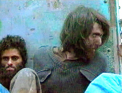 (AP Video, File). FILE - This file image taken Dec. 1, 2001, from television footage in Mazar-i-Sharif, Afghanistan, shows John Walker Lindh, right, claiming to be an American Taliban volunteer. Lindh, the young Californian who became known as the Amer...