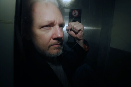 (AP Photo/Matt Dunham, File). FILE - In this May 1, 2019, file photo, WikiLeaks founder Julian Assange puts his fist up as he is taken from court in London. The Justice Department has charged Assange with receiving and publishing classified information...