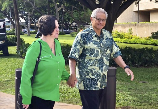 (AP Photo/Jennifer Sinco Kelleher, File). FILE - In this March 12, 2019 file photo, retired Honolulu police chief Louis Kealoha and his wife, former deputy city prosecutor Katherine Kealoha, hold hands while walking to U.S. district court in Honolulu. ...