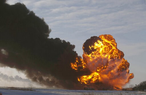 (AP Photo/Bruce Crummy, File). FILE - In this Dec. 30, 2013 file photo, a fireball goes up at the site of an oil train derailment near Casselton, N.D. The Trump administration is withdrawing a proposal for freight trains to have at least two crew membe...