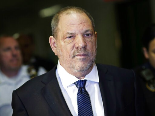 (AP Photo/Mark Lennihan, File). FILE - In this Oct. 11, 2018, file photo, Harvey Weinstein enters State Supreme Court in New York. A tentative deal is close to settling lawsuits brought against the television and film company co-founded by Weinstein, w...