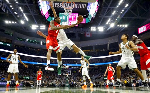 (AP Photo/Morry Gash). Toronto Raptors' Kawhi Leonard shoots past Milwaukee Bucks' Brook Lopez during the second half of Game 5 of the NBA Eastern Conference basketball playoff finals Thursday, May 23, 2019, in Milwaukee. The Raptors won 105-99 to take...
