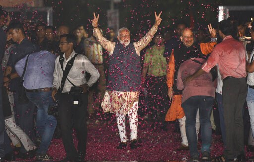 (AP Photo). Indian Prime Minister Narendra Modi and Bharatiya Janata Party (BJP) President Amit Shah greet supporters on arrival at the party headquarters in New Delhi, India, Thursday, May 23, 2019. Modi's Hindu nationalist party claimed it won reelec...