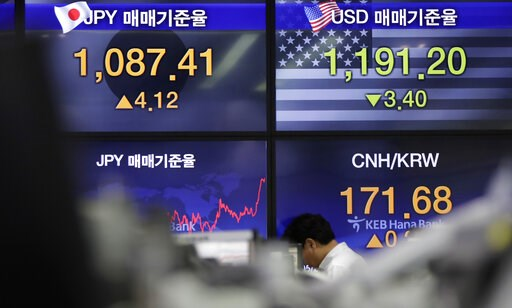 (AP Photo/Lee Jin-man). A currency trader walks near the screens showing the foreign exchange rates at the foreign exchange dealing room in Seoul, South Korea, Friday, May 24, 2019. Asian shares were mostly lower on Friday as worries that the standoff ...