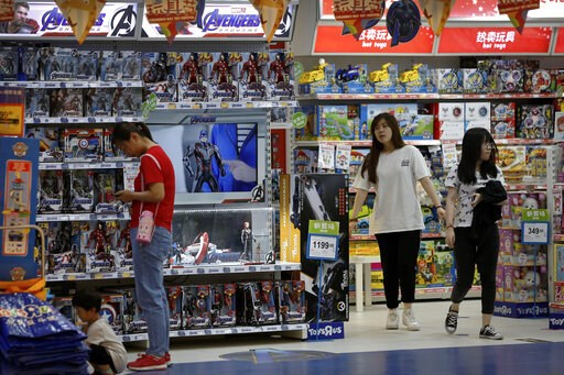 (AP Photo/Andy Wong). Customers shop near a section selling Marvel Avengers toys by American toymaker Hasbro at a toy store in Beijing, Thursday, May 23, 2019. An escalating trade war between the U.S. and China could mean higher prices on a broad array...
